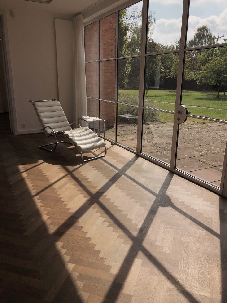 sunlight, shadow, window, day, indoors, no people, nature, flooring, architecture, absence, seat, tree, wood, glass - material, domestic room, wood - material, door, entrance, transparent