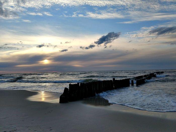 Baltic sunset Sandy Beach Waves Crashing EyeEmNewHere EyeEm Nature Lover EyeEm Best Shots EyeEm Selects Water Wave Sea Beach Sunset Beauty Sand Low Tide City Sky Tide Coastline Coast Seascape Horizon Over Water