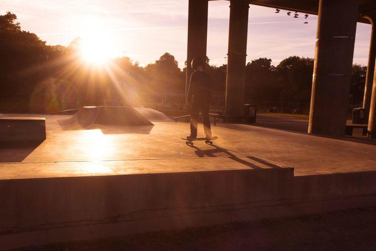 Boy Skateboarding During Sunset