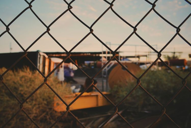 Full frame shot of chainlink fence against industry