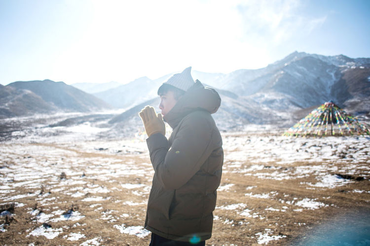 Mountain Mountain Range One Person Leisure Activity Scenics - Nature Winter Beauty In Nature Nature Real People Day Lifestyles Snow Standing Sky Land Cold Temperature Side View Clothing Warm Clothing Outdoors