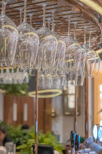 Close-up of wine glass hanging in restaurant