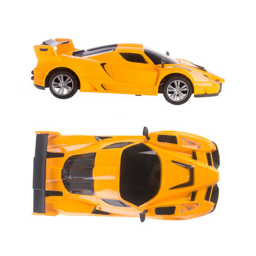 Yellow toy car on white background