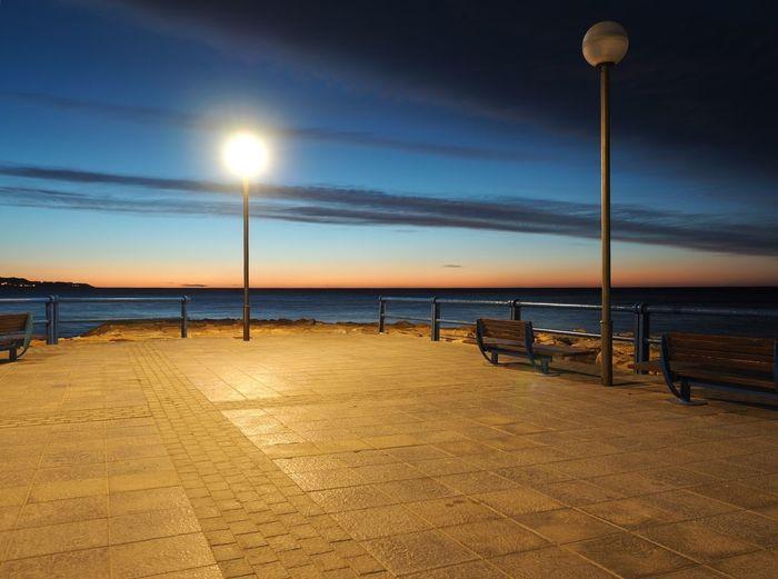 Empty pier at dusk
