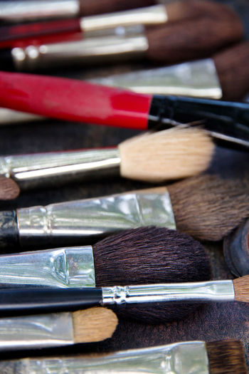 High Angle View Of Make-Up Brushes On Table