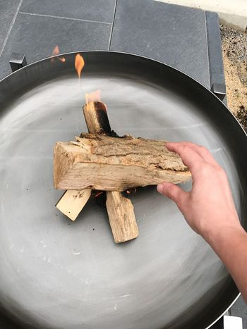 Flame Human Hand Human Body Part Real People High Angle View One Person Close-up People Grey Evening Smoke Relaxing Metal Bowl Burning Outdoors Fire Bowl Brazier Metal Wood Wood - Material Fire Garden Terrace Bonfire