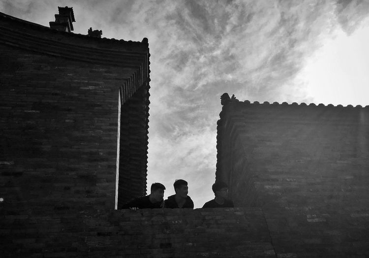 Architecture Built Structure Building Exterior History Sky Low Angle View Silhouette Cloud - Sky Real People Day Men People
