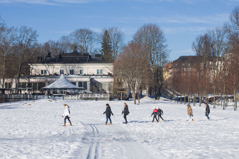 Winter Cold Temperature Snow Winter Sport Sport Nature Architecture Sky Ice Day Real People Tree Ice-skating Building Exterior Built Structure Ice Rink Bare Tree Leisure Activity Group Of People Outdoors Warm Clothing Skating