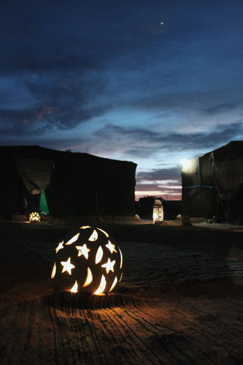 View of illuminated pumpkins against sky at night
