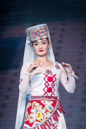 An uyghur woman is wearing her traditional costume Beautiful Northwest China Silk Road Uyghurs Xinjiang Girl Beautiful Woman Costume Editorial  Fashion Fashion Model Girl Group One Person Performance Portrait Standing Tourism Traditional Dress Travel China Travel Destinations Tribe Women Xinjiang Of CHINA Young Adult Young Women