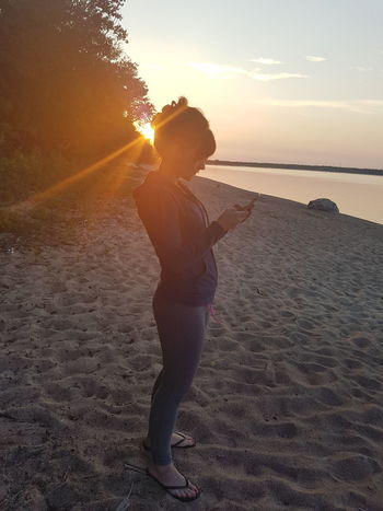 At the cottage Sunset One Person People Beach Summer Nature Only Women Standing Human Body Part One Woman Only Adult Sunlight Sun Sand Portrait Adults Only Outdoors Women Beauty Beauty In Nature Close-up Real People Tonigbt At Thd Lake halo Leisure Activity Looking At Camera