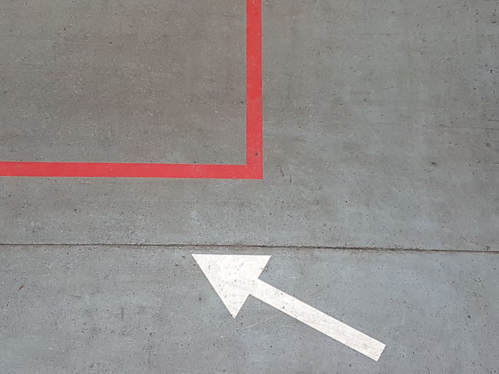 Geometric Shape This Way Entryway Red Lines RED LINE Traffic Arrow Sign Traffic Cone Traffic Sign Shapes And Forms Road Close-up Directional Sign Arrow Symbol Exit Sign Information Traffic Arrow Sign Road Marking Arrow Sign Road Sign Asphalt One Way Arrow Emergency Exit Information Sign