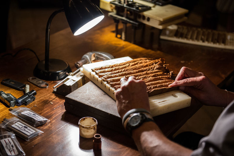 Cigar roller in action Cigar Cigar Roller Human Body Part Human Hand Indoors  Occupation Skill  Table Working