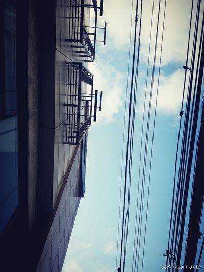 Sky Cable Cloud - Sky Low Angle View Connection Outdoors No People Built Structure Architecture Day Building Exterior Shadow High Angle View Cloud Phone Camera Phonegraphy Phonetography Phoneographer PhonePhotography Photography Low Angle View Architecture City Mall EyeEmNewHere Sky Blue Sunlight Stones