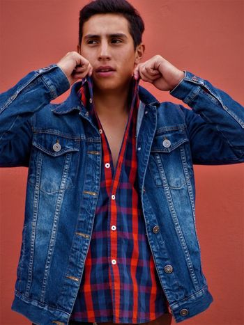 Adult Casual Clothing Close-up Colored Background Day Denim Jacket Front View Fully Unbuttoned Hands In Pockets Handsome Jacket Jeans Lifestyles One Man Only One Person One Young Man Only Only Men Outdoors People Portrait Real People Standing Studio Shot Young Adult Young Men