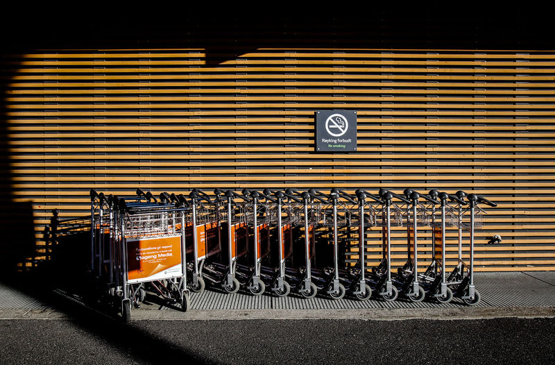Architecture Day Luggage Trolleys No People No Smoking No Smoking Sign Outdoors Shadows Wood - Material Wooden Wall
