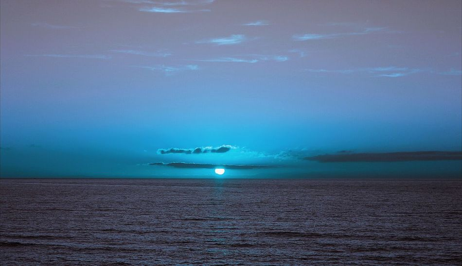 Blue Sun or Blue Moon Blue Sunset Sea Sky Colors Landscape Seascape Relaxing View Colors Of Nature Another World Atmosphere Atmospheric Sky Dramatic Sky Imagination Beautiful Place Nature Dreams Beautiful Surreal Fantasy Water Reflection Light And Shadow