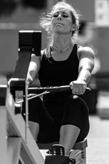 Athlete Exercising On Equipment