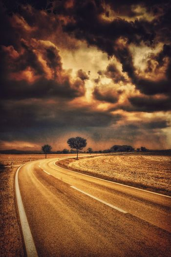 On the street in front of the great thunderstorm... Road Landscape The Way Forward Tranquil Scene Countryside Cloud - Sky Cloud Sky Tranquility Cloudy Outdoors Non-urban Scene Road Capture The Moment Austria A Photo Like A Painting Tranquility Melancholic Landscapes Mystical Atmosphere