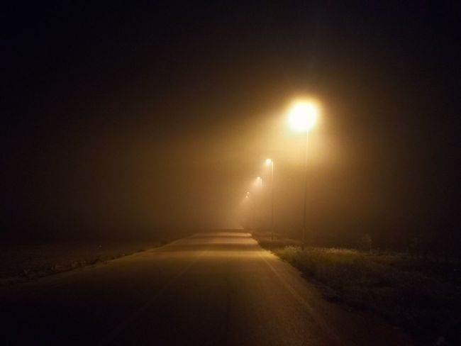 """""""Lost in a foggy way"""" Foggy Weather Foggy Way Puglia South Italy Puglia Italy🇮🇹 No Filter No Filter, No Edit, Just Photography Nofilter Night Illuminated Road Dark Outdoors No People Street Light Fog"""