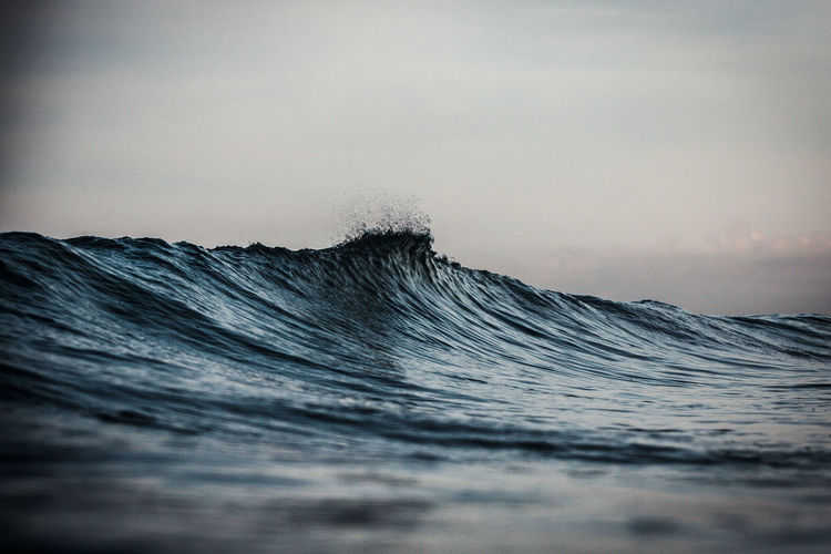 Close-up of waves in sea against sky