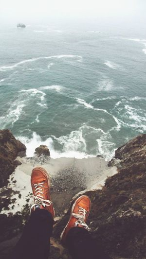Sea Shoe Low Section Human Body Part Personal Perspective Beach Water Human Leg Human Foot One Person Cliff Adventure One Man Only Leisure Activity Outdoors Sand Wave Scenics Day Vacations