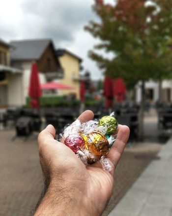 Yummy 🍫 🇨🇭 Human Body Part Human Hand One Person Personal Perspective Sweet Food Holding Focus On Foreground Building Exterior Food And Drink Architecture Lifestyles Temptation Close-up Outdoors Chocolate Choclates Second Acts Be. Ready.