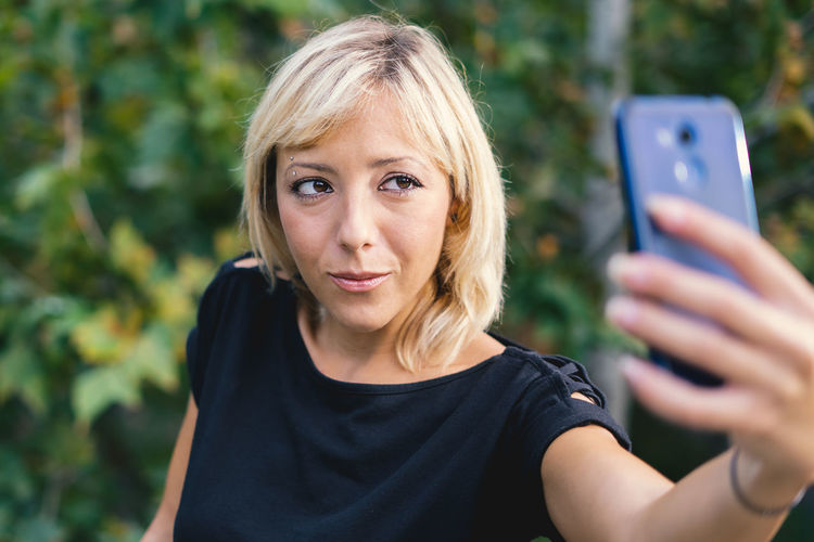 Blond Woman Taking Selfie With Mobile Phone