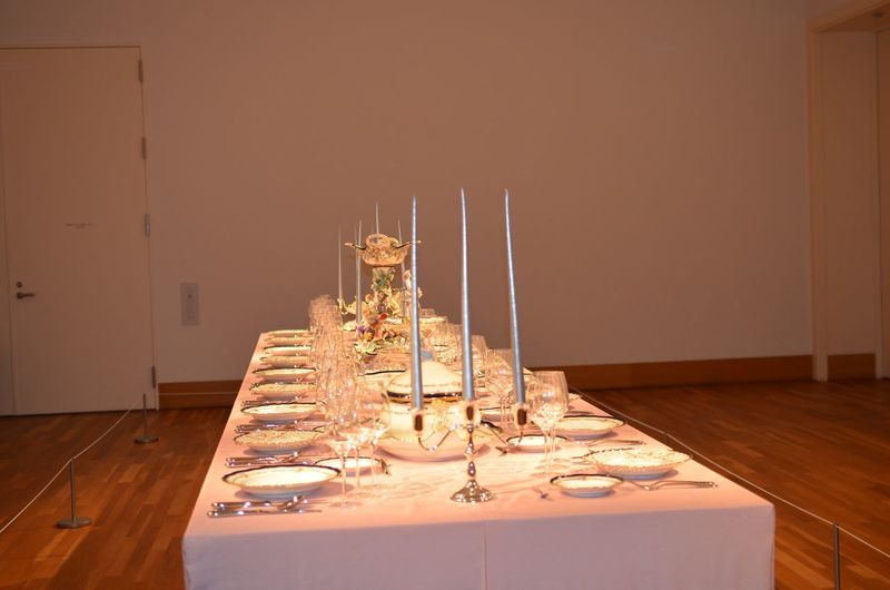 High angle view of dining table with candles