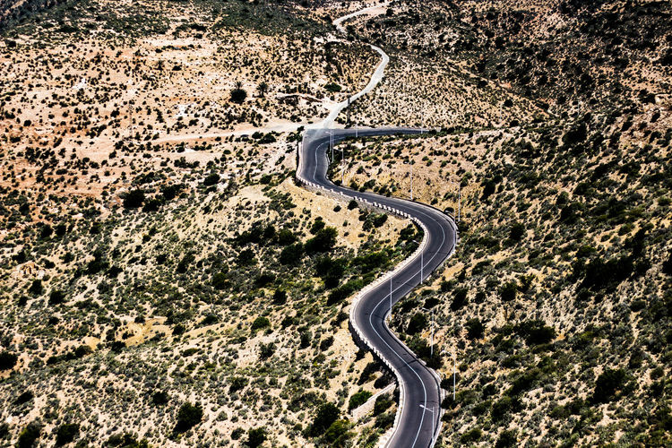 A Street Road Aerial View No People Curve Day Transportation Nature Mountain Environment Scenics - Nature Landscape Beauty In Nature Winding Road High Angle View Non-urban Scene Outdoors Travel Land Tranquility Tranquil Scene Mountain Road Above