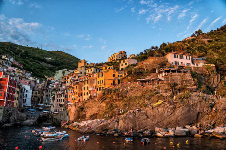 Riomaggiore in sunset Building Exterior Architecture Built Structure Water Sky Building Mountain Residential District Nature Rock Rock - Object Sea Rock Formation Solid Day City Cloud - Sky House No People Outdoors TOWNSCAPE Sunset Cinque Terre Italy