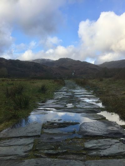The path to Easedale Tarn, Grasmere, Lake District Blue Sky Stone Path Lake District Grasmere Easedale Tarn Path Cloud - Sky Sky Nature Tranquility Tranquil Scene Scenics Beauty In Nature Day Outdoors Mountain Landscape No People Grass