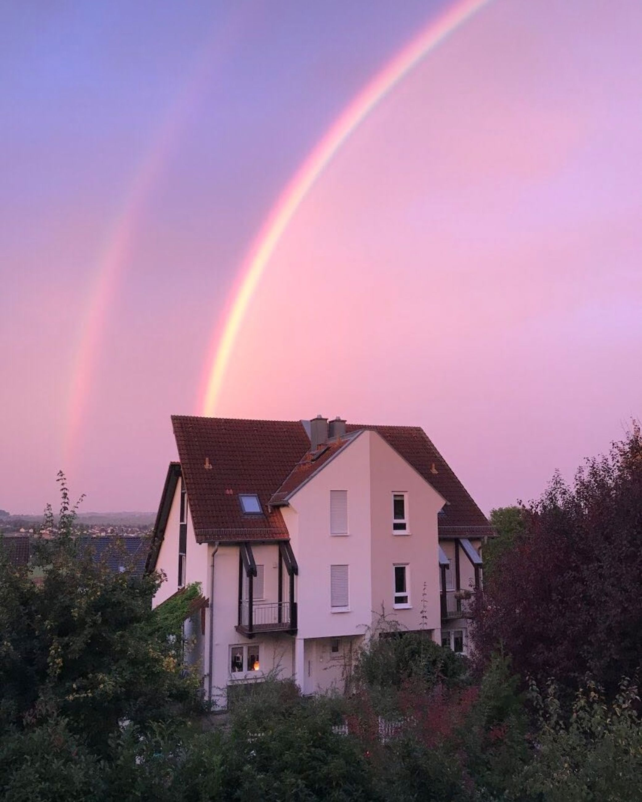 built structure, architecture, tree, plant, house, building exterior, sky, building, no people, rainbow, beauty in nature, nature, residential district, multi colored, idyllic, scenics - nature, low angle view, outdoors, roof, double rainbow