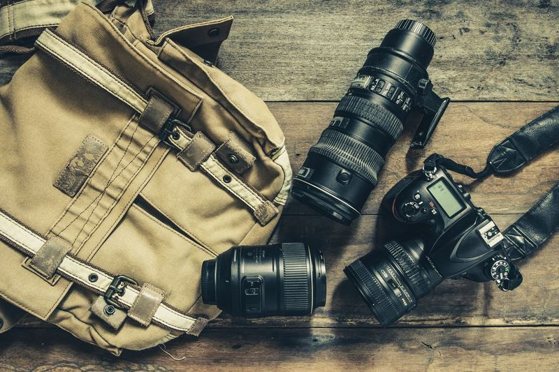 cameras and Lens and photography equipment Photography Camera Lens Vintage High Angle View Still Life Table Indoors  No People Close-up Metal Technology Camera - Photographic Equipment Wood - Material Equipment Photographic Equipment Camera Day Flooring Photography Themes
