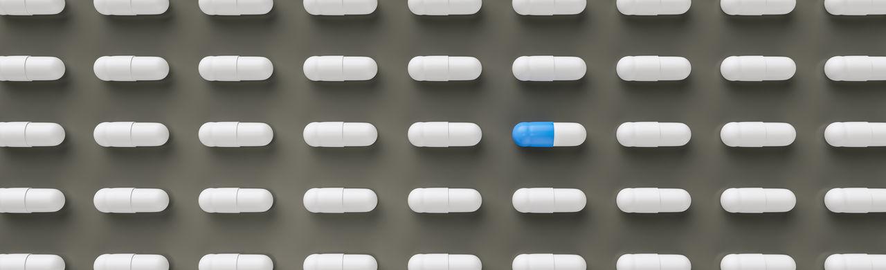 Full frame shot of capsules against gray background