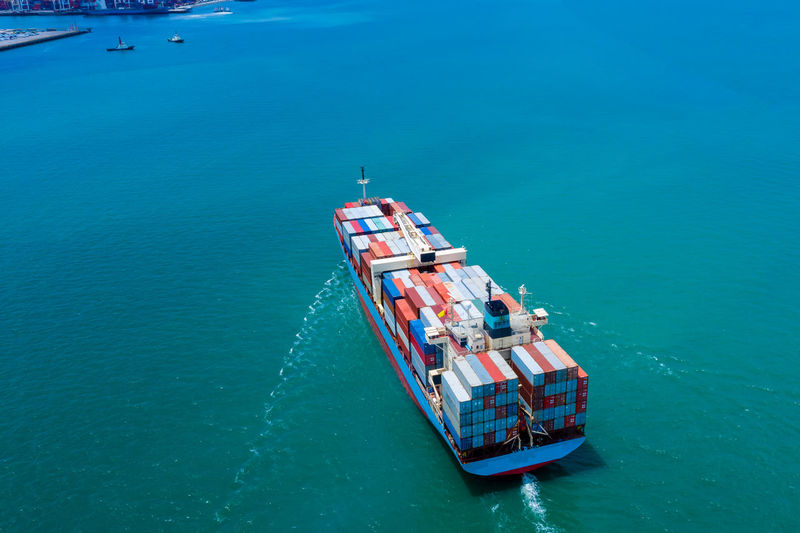 Industry business service logistics cargo containers ship import export by the sea camera from drone