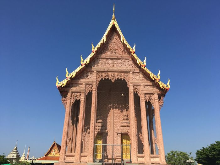 Buddhism Religious Sites Thai Art Church Architecture Built Structure Sky Clear Sky Religion Belief Low Angle View Building Exterior Ornate Day The Past Travel Destinations History No People Spirituality Blue Building Place Of Worship Nature Architectural Column