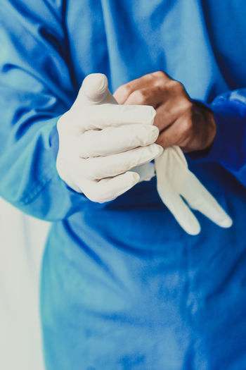 Close-up of hands holding blue finger
