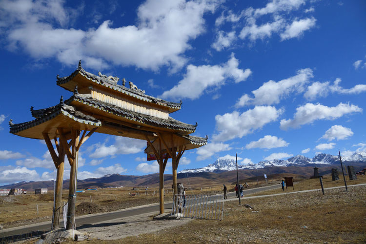 The gate of Tibet temple in China with snow mountian China Gate Tibet Temple Himalayas Chinese Buddha Travel Mountain Snow Sky Tourism ASIA Wood - Material Entrance