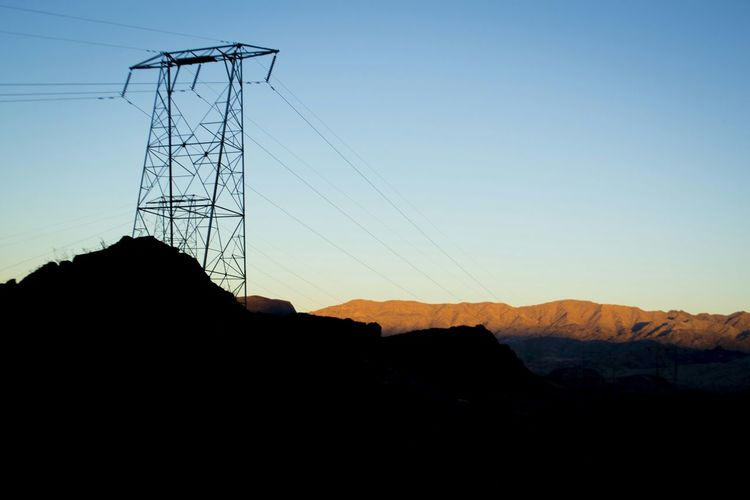 Electricity pylons on mountain
