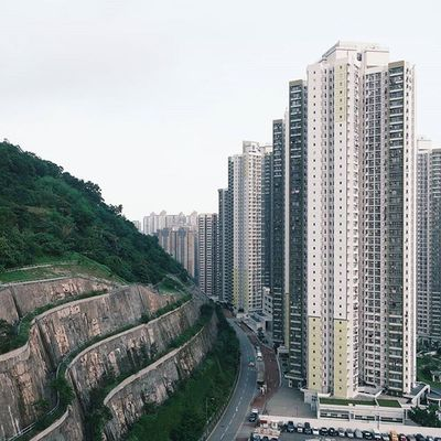 urban-nature | 平衡 🏢 • conquering nature in the hongkong style - cutting down slopes for buildings. btw, choi fook estate, in this photo, is one of the latest victims of the recent lead water scandal. • || Discoverhongkong | Residensity | Kby_publichousing ||