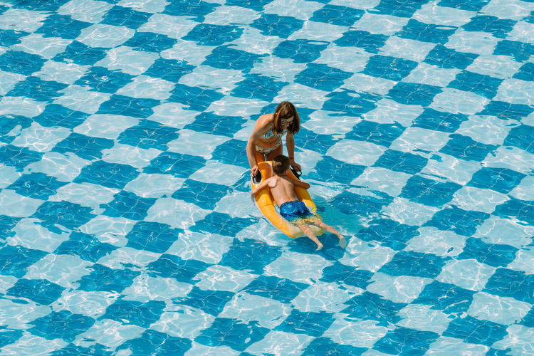 High angle view of woman walking in swimming pool