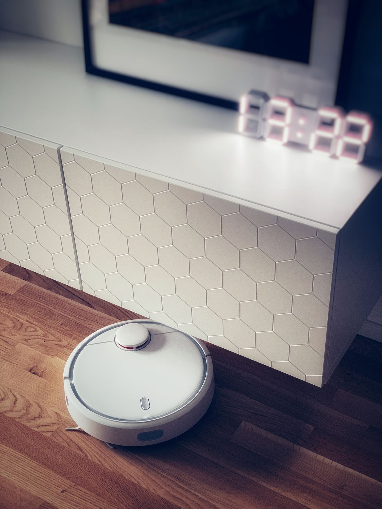 High angle view of robotic vacuum cleaner at home