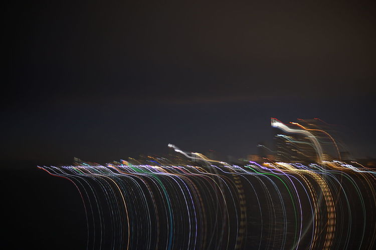 Light trails against clear sky at night
