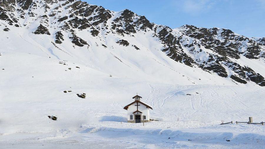 Chapel against snowcapped mountain