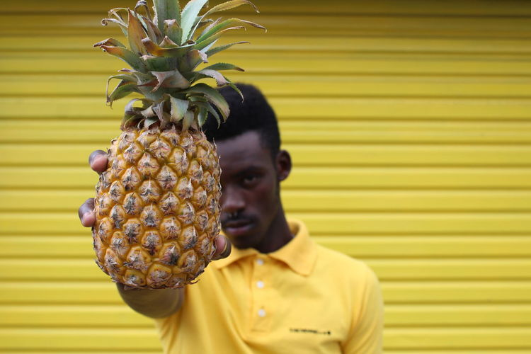 Food Food And Drink Freshness Front View Fruit Headshot Healthy Eating Leisure Activity Lifestyles One Person Outdoors Pineapple Portrait Real People Ripe Tropical Fruit Wellbeing Yellow Young Adult Young Men The Fashion Photographer - 2018 EyeEm Awards A New Perspective On Life
