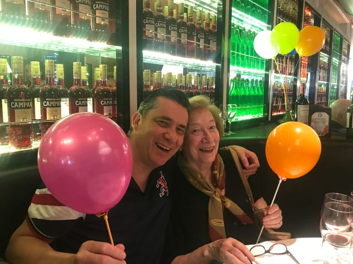Happy biryhday mom Togetherness Smiling Adult Two People Happiness Emotion Men Love Balloon Positive Emotion Portrait Women Young Men Young Adult Bonding Alcohol Celebration Glass