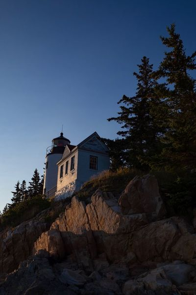 Bass Harbor 2 Architecture Light And Shadow Adventure Cliffs Sunset Ocean Fujifilm Bass Harbor Lighthouse Lighthouse Maine Acadia National Park Travel Landscape Built Structure Tree Architecture Building Exterior Plant Sky Nature Low Angle View Building Clear Sky No People History Blue Outdoors Copy Space Growth