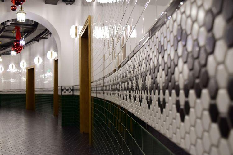 Illuminated lights hanging on wall