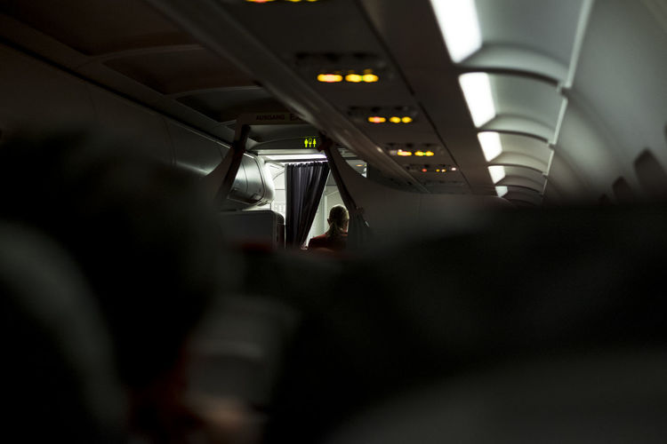 Rear view of air hostess in airplane